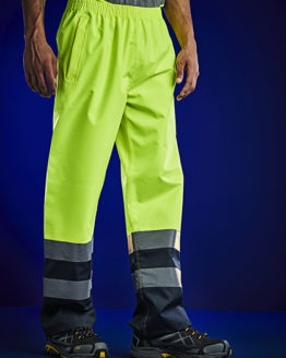 Hosen von der Marke Regatta High Visibility namens Hi-Vis Pro Over Trousers in der Farbe Yellow